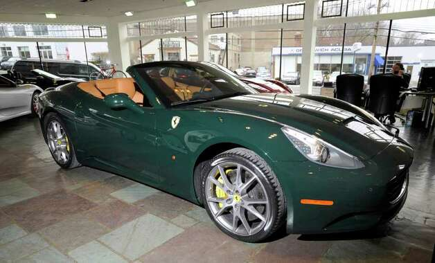 A 2012 Ferrari California on display inside Miller Motorcars at 342 W. Putnam Ave. in Greenwich Wednesday, Feb. 15, 2012. The front-engine, V-8 powered convertible lists for $217,000. Photo: Bob Luckey / Greenwich Time