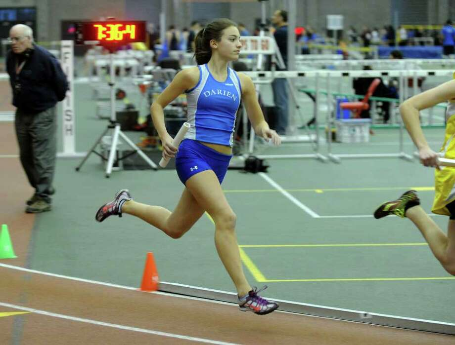 Darien's Caroline Weihs competes during the FCIAC track championships at the New Haven Athletic Center earlier this month. Wednesday, the CIAC stripped the Blue Wave of their Class L chapionship, declaring them runner-up after discovering a a scoring error. Widsor is the new champion. Photo: Christian Abraham / Connecticut Post