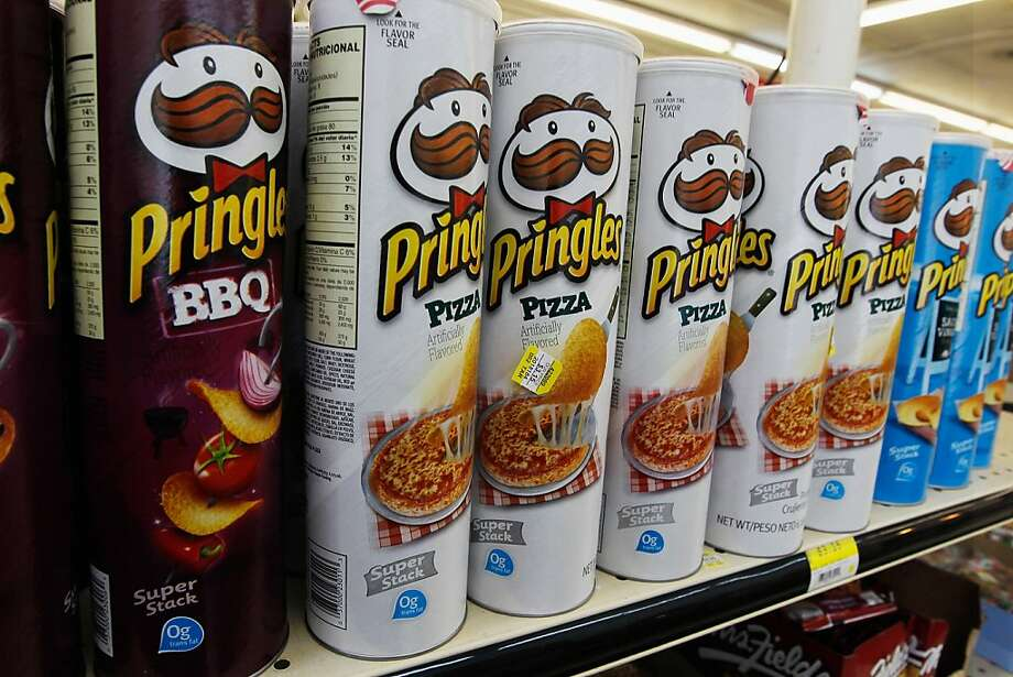 MIAMI, FL - FEBRUARY 15:  Packages of Pringles chips are seen on desplay at a convience store on February 15, 2012 in Miami, Florida. Procter & Gamble announced it will sell its Pringles product line to cereal-maker Kellogg for $2.7 billion after a deal with Diamond Foods fell through.  (Photo by Joe Raedle/Getty Images) Photo: Joe Raedle, Getty Images