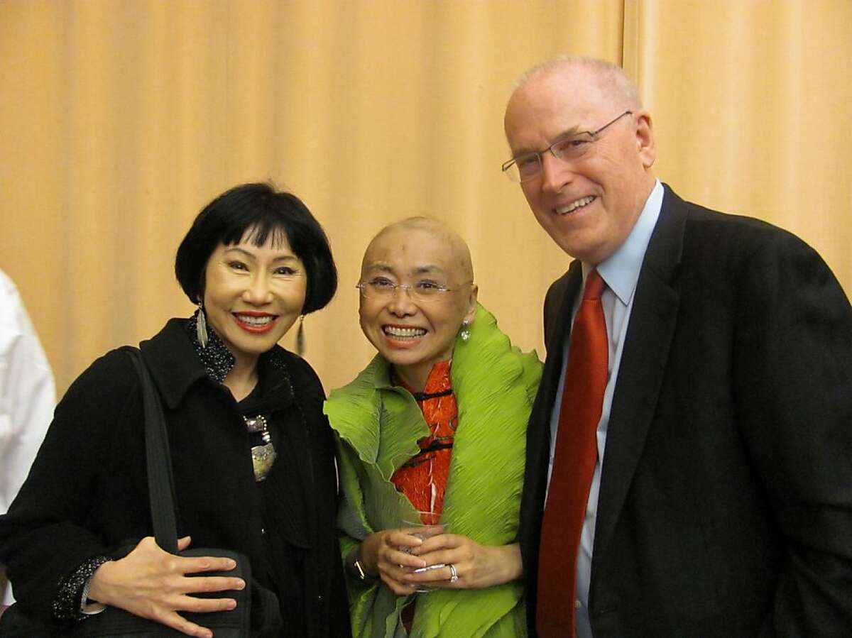 """Mezzo soprano Zheng Cao, who was battling cancer, was honored Tuesday by the San Francisco Opera's Merola Opera Program with the creation of a fund to help either Asian-Pacific Islander or mezzo soprano opera students study with Merola in Feb. 2012. She is show above, center, with her husband, Dr. David Larson, and her longtime friend Amy Tan, author of """"The Bonesetter's Daughter."""" Cao starred in the world premiere of the opera based on Tan's novel."""