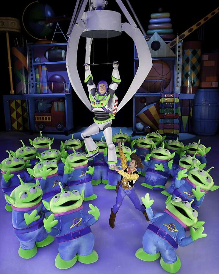 """Woody attempts to rescue Buzz from """"The Claw"""" in Disney On Ice presents Disney Pixar s Toy Story 3, coming to San Jose Feb 22-29 and Oakland Feb 29-Mar 4.  Photo credit: Courtesy of Feld Entertainment Photo: Feld Entertainment"""