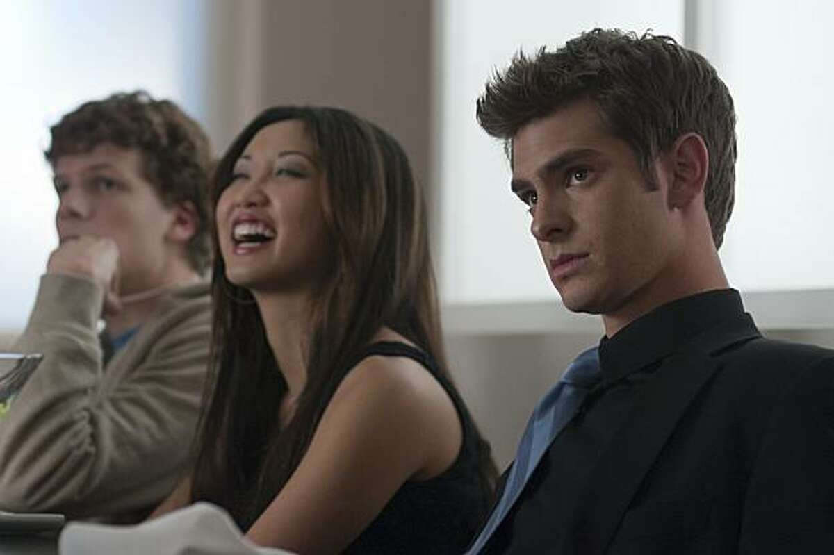 """L-r, Jesse Eisenberg, Brenda Song and Andrew Garfield in Columbia Pictures' """"The Social Network."""""""