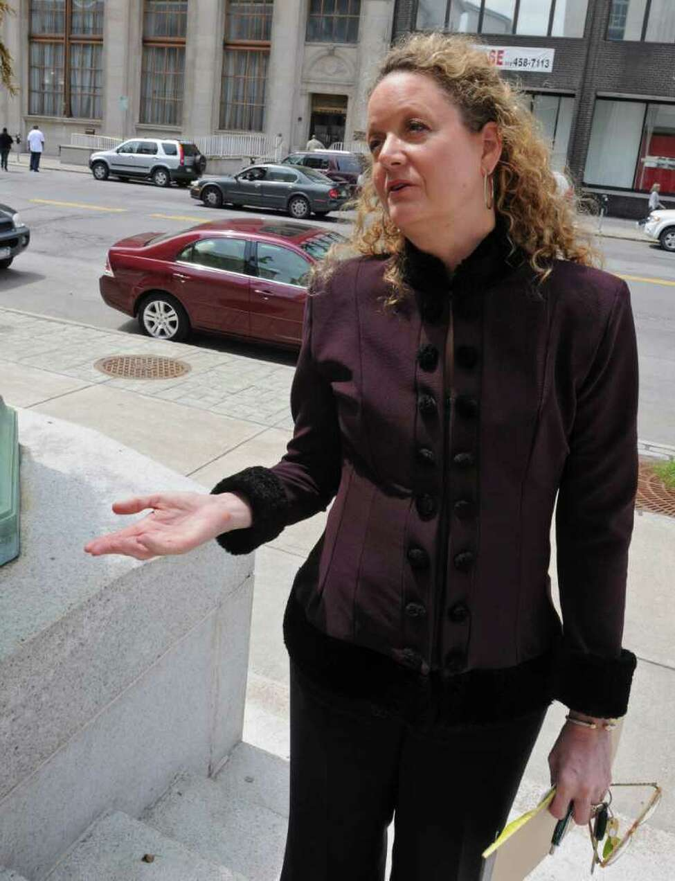 Barbara Bouchey stands outside the Federal Courthouse on Broadway in Albany, N.Y. on Tuesday May 3, 2011. (Lori Van Buren / Times Union)