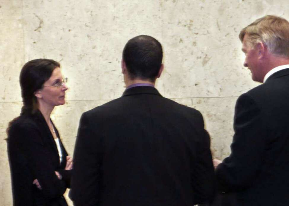 Clare Bronfman in the hallway of the Los Angeles County Courthouse March 28, 2011. Robert Crockett, far right, and other members of her legal team are also pictured. (Special to the Times Union)