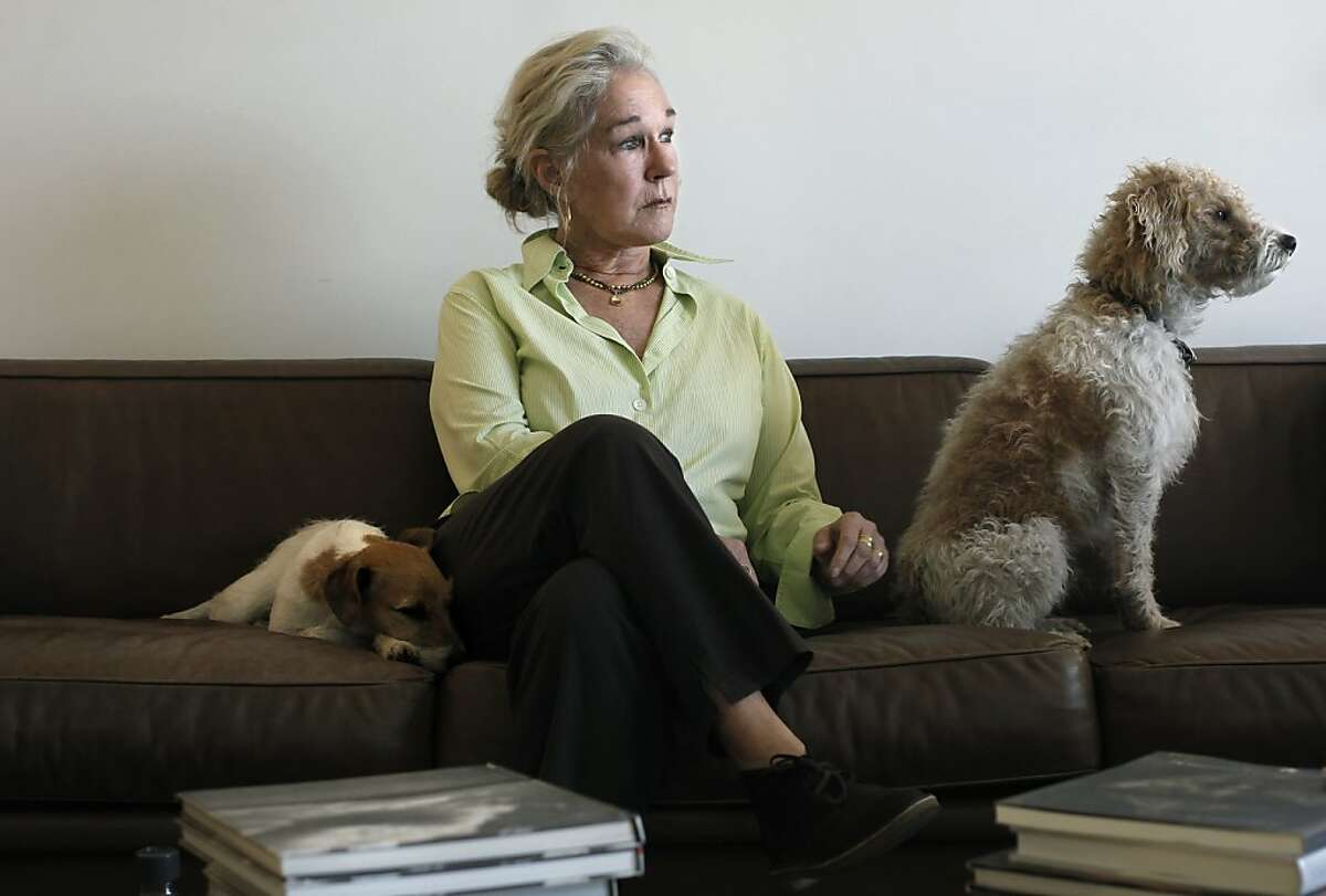 Susie Tompkins Buell, at her home in San Francisco, Ca. on Tuesday Feb. 14, 2012, with her dogs, Hazel, (left) anf Tommy. Buell, one of the country's most generous political donors, has long used her checkbook and her compassion to sway Democratic politics on the national scene.