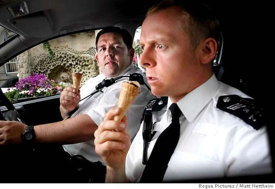 Nick Frost (left) and Simon Pegg (right) star in Edgar Wright's new action comedy HOT FUZZ, a Rogue Pictures release  Photo credit: Matt Nettheim Photo: Matt Nettheim