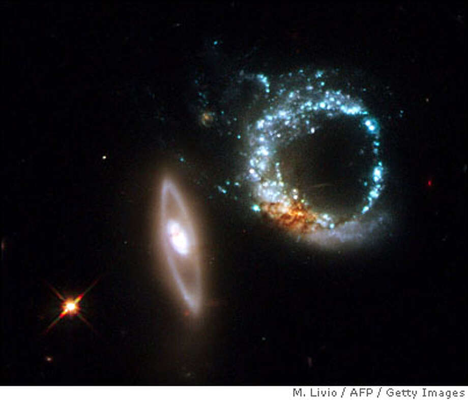 An image taken by Hubble Space telescope and released on October 30, 2008 by European Space Agency (ESA), shows a pair of gravitationally interacting galaxies called Arp 147, photographed on October 27-28, 2008. Arp 147 lies in the constellation of Cetus, more than 400 million light-years away from Earth.