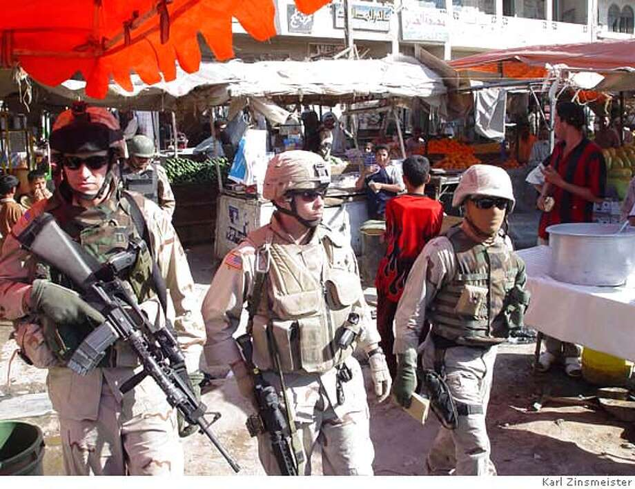 File name: Warriors_03  Caption: Soldiers patrolling a market in Baghdad, Iraq.  Credit: Karl Zinsmeister Photo: Karl Zinsmeister