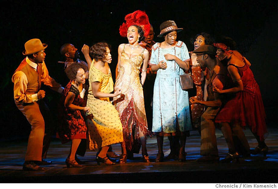 """PURPLE15_101_KK.JPG  Dress rehearsal of """"The Color Purple"""" a broadway adaptation of Alice Walker's Pultizer Prize winning book. Michelle Williams as Shug (center left, singing) and Jeanette Bayardelle as Celie (center right, with purse) perform in the first act.  Photo by Kim Komenich/The Chronicle  **Jeanette Bayardelle, Michelle Williams Photo: Kim Komenich"""
