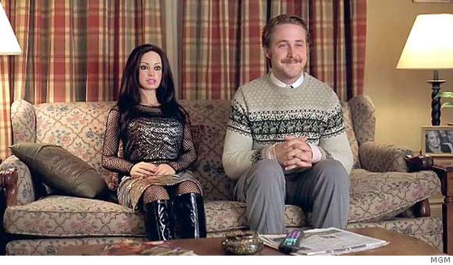"In ""Lars and the Real Girl"" Ryan Gosling plays a man who treats a doll as if she is a real, live girlfriend.  Ran on: 10-14-2007  &quo;Lars and the Real Girl&quo; stars Paul Schneider (from left) as Gus; Emily Mortimer as his wife, Karin; and Ryan Gosling is Gus' brother Lars, who believes the doll he calls Bianca is his real girlfriend. Photo: MGM"