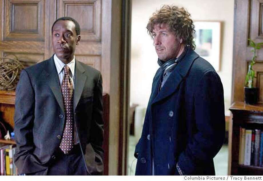 "In this photo provided by Columbia Pictures, Don Cheadle and Adam Sandler star in ""Reign Over Me."" (AP Photo/Columbia Pictures/Tracy Bennett) NO SALES. NO MAGS. Photo: Tracy Bennett"