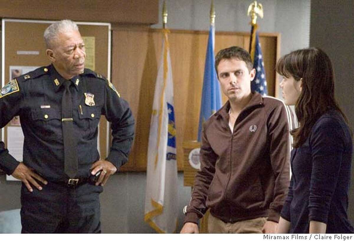 Morgan Freeman as Doyle, Casey Affleck as Patrick, and Michelle Monaghan as Angie in GONE BABY GONE. Photo credit: Claire Folger/Courtesy of Miramax Films.