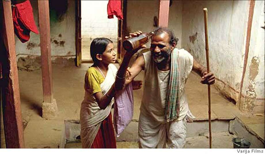 Somayya, Vanaja's father (Ramachandriah Marikanti), is stone drunk. Toddy bottle, and bamboo cane in hand, he's raving as Vanaja (Mamatha Bhukya) tries to control him. Toddy is an extremely potent alcoholic beverage that is made from the fruit of Toddy-Palm trees. Photo: HO From Varija Films Pvt. Ltd.