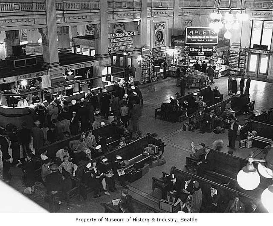 King Street Station opened to passenger service in May of 1906, with a grand, soaring ceiling; marble columns and beautiful floor tiles. The architectural firm that designed Grand Central Station in New York designed King Street, pictured in 1943.  Photo: Seattle Post-Intelligencer Via MOHAI.
