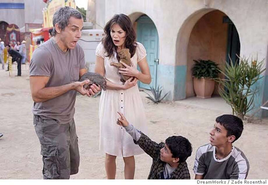 Mistaking a rodent for a house pet is just one of the unpleasant surprises Eddie (Ben Stiller, left) is in for during his honeymoon, when he also meets and falls in love with another woman, Miranda (Michelle Monaghan), in The Heartbreak Kid. CREDIT: ZADE ROSENTHAL 2007 DreamWorks LLC. All Rights Reserved. Photo: ZADE ROSENTHAL Photo Credit: Zad