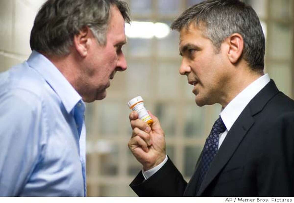 """Warner Bros. Pictures provided this photo of (left to right) Tom Wilkinson and George Clooney in """"Michael Clayton."""" (AP Photo/Warner Bros. Pictures/Myles Aronowitz) NO SALES. HANDOUT PHOTO"""