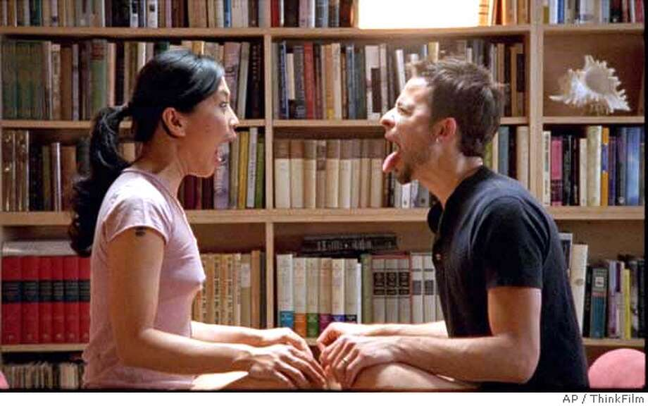 "Sofia (Sook-Yin Lee) and Rob (Raphael Barker) in ""Shortbus,"" directed by John Cameron Mitchell. ThinkFilm photo via Associated Press"