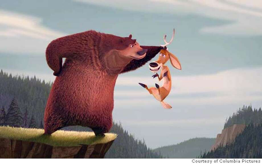 Martin Lawrence as Boog the grizzly bear and Ashton Kutcher as Elliot, the one-horned mule deer in Columbia's Open Season - 2006 Photo: Columbia Pictures