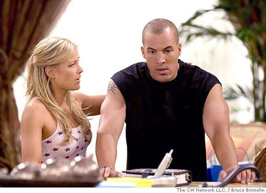 """Gift"" --Pictured (L-R) Brittany Daniel as Kelly Pitts and Coby Bell as Jason Pitts in THE GAME on The CW.Photo: Bruce Birmelin/The CW�2006 The CW Network LLC. All Rights Reserved. MANDATORY CREDIT; ; NO ARCHIVE; NORTH AMERICAN USE ONLY Photo: Bruce Birmelin"