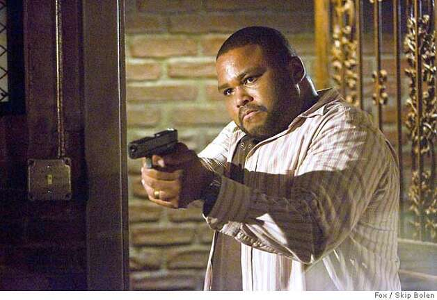 "K-VILLE: Boulet (Anthony Anderson) draws his gun with anticipation in the K-VILLE episode ""Cobb's Web"" airing Monday, Sept. 24 (9:00-10:00 PM ET/PT) on FOX. CR: Skip Bolen/FOX Fox / Skip Bolen Photo: Ho"