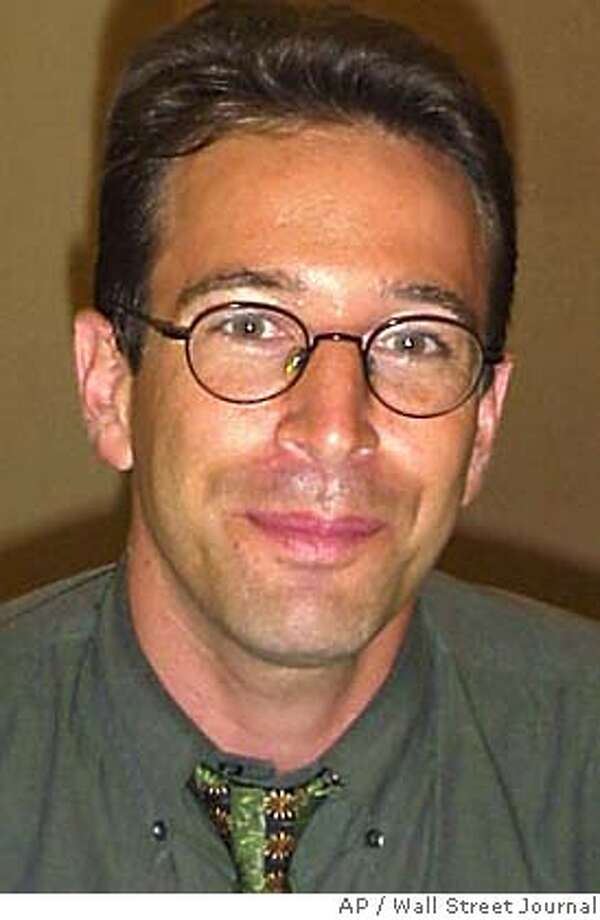 ** FILE ** Wall Street Journal reporter Daniel Pearl is shown in this undated file photo. American authorities investigating the killing of Pearl in Pakistan now believe that he was slain by Khalid Shaikh Mohammed, the alleged mastermind of the Sept. 11 attacks. (AP Photo/Wall Street Journal)  ALSO RAN: 1/1/2004 Daniel Pearl, left, was slain by Khalid Shaikh Mohammed, right, U.S. officials say. Photo caption pearl22_PH11012003200WALL STREET JOURNAL** FILE ** Wall Street Journal reporter Daniel Pearl is shown in this undated file photo. American authorities investigating the killing of Pearl in Pakistan now believe that he was slain by Khalid Shaikh Mohammed, the alleged mastermind of the Sept. 11 attacks. (AP Photo-Wall Street Journal)__NO SALES UNDATED PHOTO cat UNDATED PHOTO This photo was in an early 2002 e-mail saying Daniel Pearl was being held to protest treatment of prisoners at Guantanamo Bay. Judea Pearl speaks at an Arlington, Va., ceremony honoring 31 journalists who died in the line of duty in 2002. Ran on: 09-10-2005  Daniel Pearl's killing has led his father on a quest to foster understanding between Jews and Muslims. Ran on: 09-10-2005  Daniel Pearl's killing has led his father on a quest to foster understanding between Jews and Muslims. Nation#MainNews#Chronicle#1/1/2004#ALL#3star##0421449659 Photo: Wall Street Journal