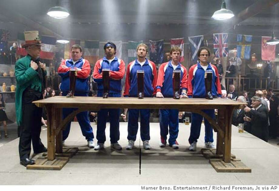 "In this photo provided by Warner Bros. Entertainment, Philippe Brenninkmeyer as Herr Referee stands at the end of the table occupied by Team USA: Kevin Heffernan as Landfill, Jay Chandrasekhar as Barry, Paul Soter as Jan Wolfhouse, Erik Stolhanske as Todd Wolfhouse and Steve Lemme as Fink in ""Beerfest."" (AP Photo/Warner Bros. Entertainment/Richard Foreman, Jr.) Photo: RICHARD FOREMAN, JR."
