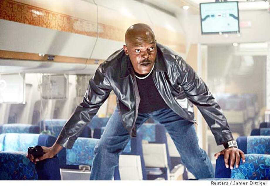 "Actor Samuel L. Jackson is shown in a scene from the new action feature film ""Snakes On A Plane"" in this undated handout photograph. After endless parodies, Weblogs, videos, books, news reports and T-shirts, ""Snakes on a Plane"" finally opens in the United States on August 18, 2006 with no one knowing quite what to expect from the super-hyped film other than a story about reptiles patrolling a panicky passenger jet. To match feature LEISURE SNAKES. NO ARCHIVES FOR EDITORIAL USE ONLY REUTERS/James Dittiger/New Line Productions/Handout (UNITED STATES) Photo: HO"