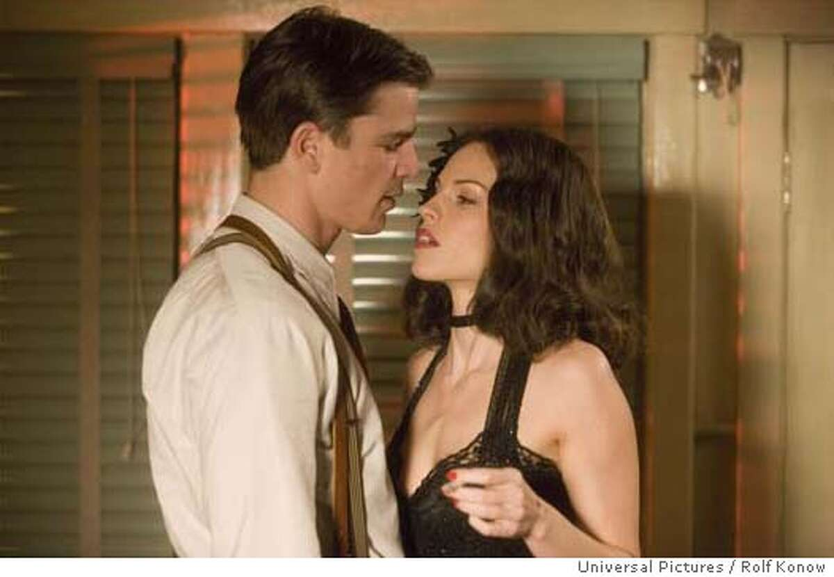 Cop Bucky Bleichert (JOSH HARTNETT) and enigmatic socialite Madeleine Linscott (HILARY SWANK) in the 1940s thriller The Black Dahlia, directed by Brian De Palma. The Black Dahlia weaves a fictionalized tale of obsession, love, corruption, greed and depravity around the true story of the brutal murder of a fledgling Hollywood starlet that shocked and fascinated the nation in 1947 and remains unsolved today. The Black Dahlia will be released in theaters on September 15, 2006. Credit: Rolf Konow / Universal Pictures