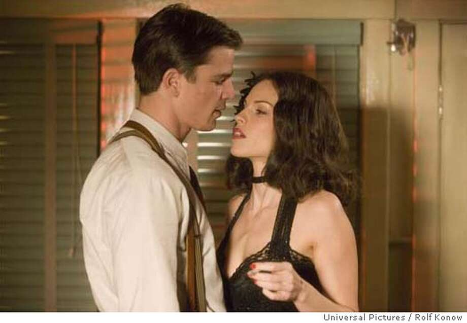 Cop Bucky Bleichert (JOSH HARTNETT) and enigmatic socialite Madeleine Linscott (HILARY SWANK) in the 1940s thriller The Black Dahlia, directed by Brian De Palma. The Black Dahlia weaves a fictionalized tale of obsession, love, corruption, greed and depravity around the true story of the brutal murder of a fledgling Hollywood starlet that shocked and fascinated the nation in 1947 and remains unsolved today. The Black Dahlia will be released in theaters on September 15, 2006. Credit: Rolf Konow / Universal Pictures Photo: Ho