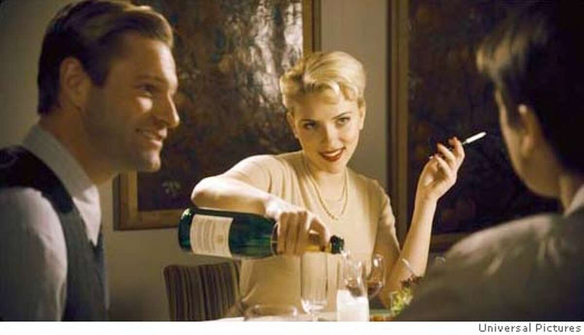 (L to R) Cop Lee Blanchard (AARON ECKHART), Lee�s Girlfriend, Kay Lake (SCARLETT JOHANSSON), and Bucky Bleichert (JOSH HARTNETT) in the 1940s thriller The Black Dahlia, directed by Brian De Palma. The Black Dahlia weaves a fictionalized tale of obsession, love, corruption, greed and depravity around the true story of the brutal murder of a fledgling Hollywood starlet that shocked and fascinated the nation in 1947 and remains unsolved today. The Black Dahlia will be released in theaters on September 15, 2006. Credit: Universal Pictures
