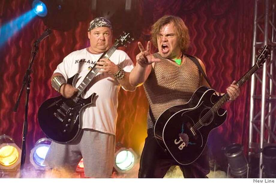 "�In this photo provided by New Line, Kyle Gass (KG) and Jack Black (JB) have formed a band the likes of which has never been seen in ""Tenacious D and the Pick of Destiny."" (AP Photo/New Line) Photo: New Line"