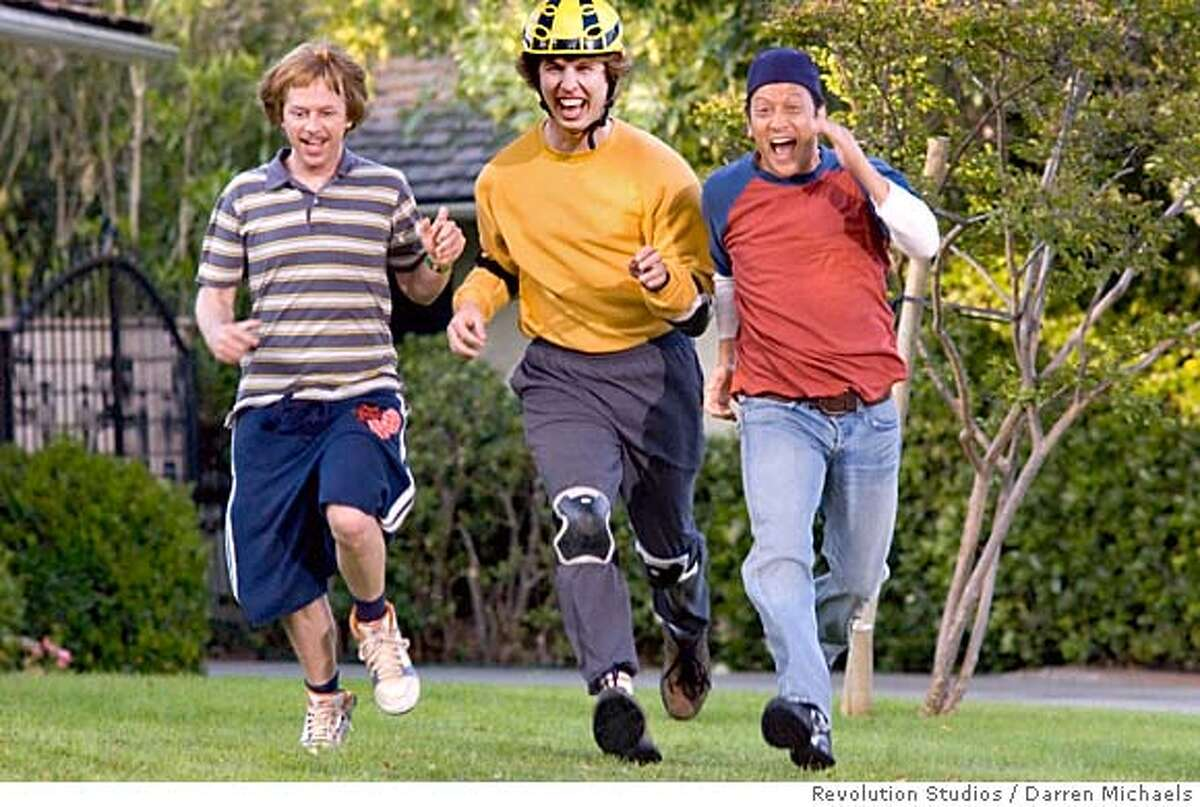 In this undated photo released by Revolution Studios, actors from left, David Spade, Jon Heder and Rob Schneider appear in a scene from