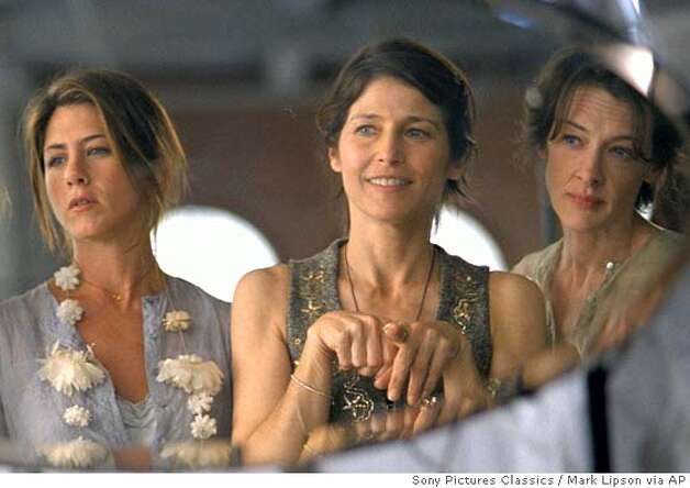 In this photo provided by Sony Pictures Classics, Olivia (Jennifer Aniston), Christine (Catherine Keener) and Franny (Joan Cusack) are life-long friends, who have achieved a level of comfort in their lives and have now settled into a life of designer clothes, charity events, and caring for the men (and offspring) in their lives in 'Friends with Money.' (AP Photo/Sony Pictures Classics/Mark Lipson) Photo: MARK LIPSON
