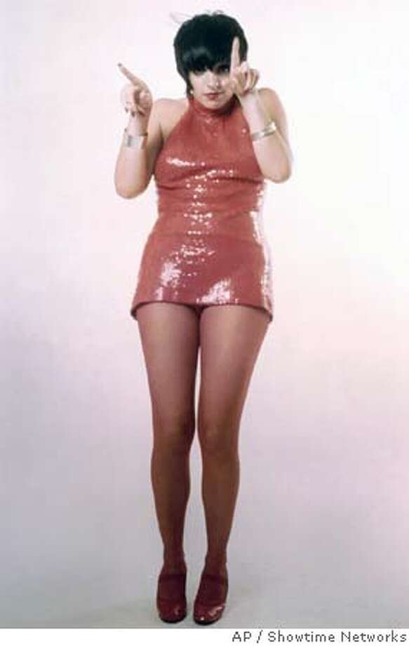 """This photo, released by Showtime Networks, shows Liza Minnelli in the red squinned mini dress she wore during her May 31, 1972 performance of """"Liza with a 'Z'."""" That performance, which captures Liza in a full-rev concert at Broadway's Lyceum Theater shot documentary-style with eight 16mm cameras, aired on NBC that September, making a splash and winning a Peabody Award as well as four Emmys. The show, recently rescued from near ruin and fully restored frame by frame, with the sound remixed in Dolby 5.1 stereo, airs on Showtime Saturday at 8 p.m., EST. (AP Photo/Showtime Networks) UNDATED HANDOUT PHOTO FROM SHOWTIME Photo: X"""