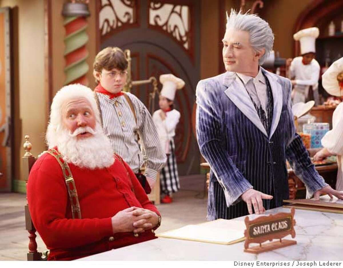 In this photo provided by Disney Enterprises, actors from left, Tim Allen, Spencer Breslin and Martin Short, appear in a scene from