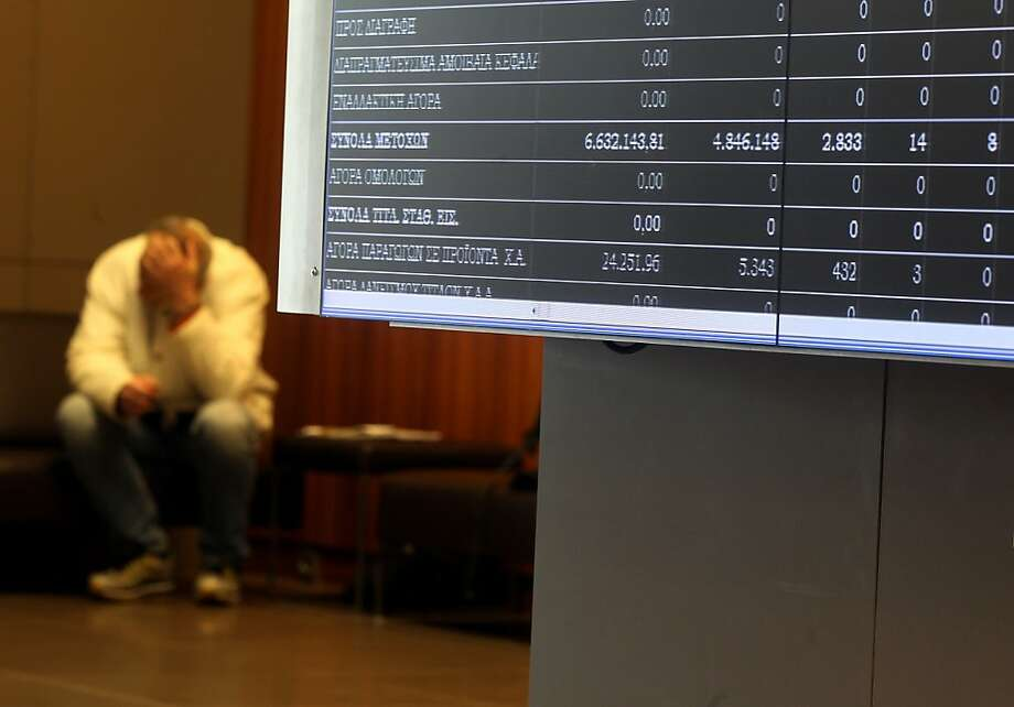 Electronic screens display stock prices inside the Greek stock exchange iin Athens, Greece, on Wednesday, Feb. 15, 2012. European officials ratcheted up the pressure on the Greek government to deliver budget cuts in exchange for a second bailout as they insisted that default is not an option. Photographer: Simon Dawson/Bloomberg Photo: Simon Dawson, Bloomberg