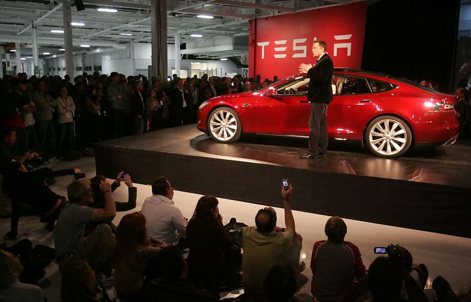 Tesla CEO Elon Musk shows off the company's Model S during an event last year. Photo: Mathew Sumner, Special To The Chronicle
