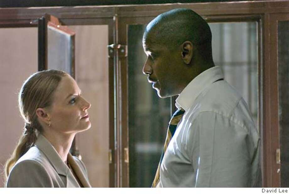 Detective Keith Frazier (DENZEL WASHINGTON) and Madeline White (JODIE FOSTER), a power broker with a hidden agenda, match wits in Inside Man, a tense hostage drama from Director Spike Lee. Inside Man will be released in theaters on March 24, 2006.  Credit: David Lee Photo: X