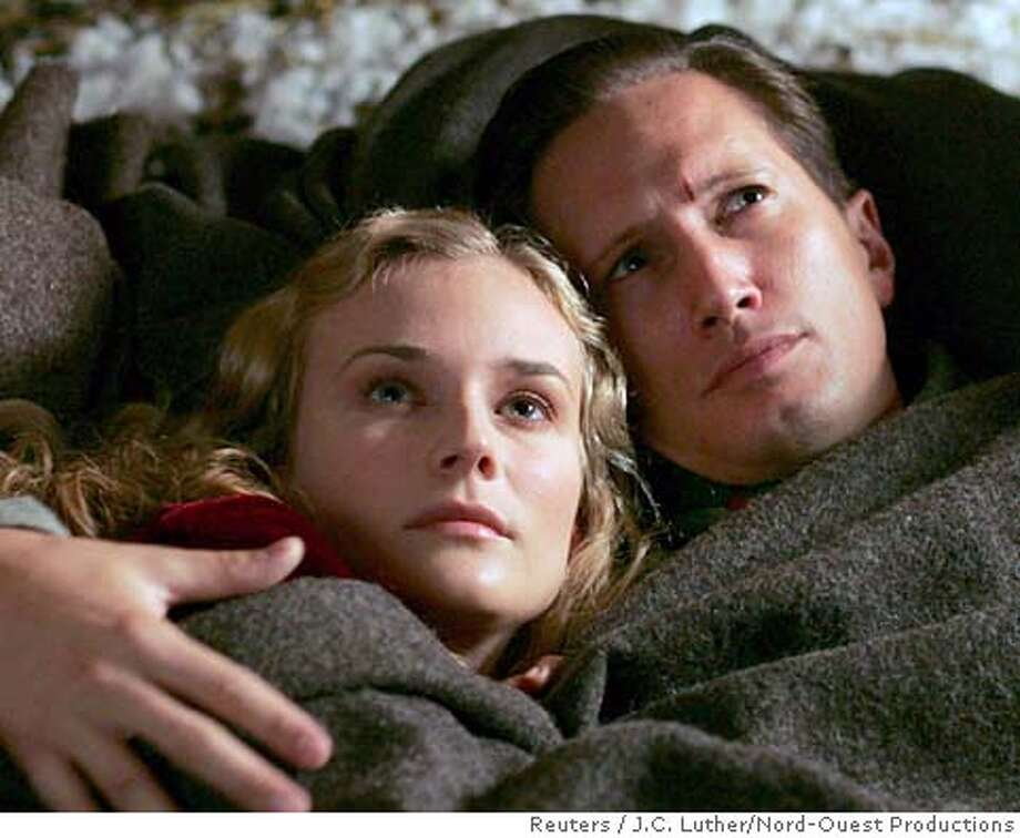 """Actress Diane Kruger (L) and actor Benno Furmann are shown in a scene from the French film """"Joyeux Noel"""" in an undated publicity photo. The film received a nomination for best foreign language film for the upcoming 78th Academy Awards. The nominations were announced in Beverly Hills, California January 31, 2006 and the Oscars will be presented March 5, 2006. NO ARCHIVES REUTERS/J.C. Luther/Nord-Ouest Productions/handout 0 Photo: Nord-Ouest Productions"""