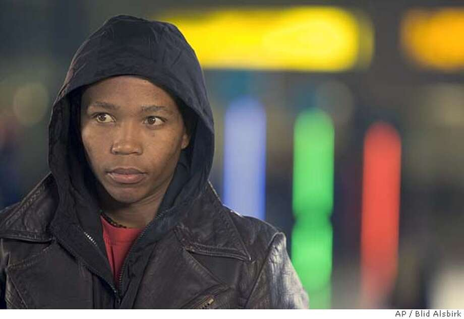 """In this photo provided by Miramax, Presley Chweneyagae as Tsotsi, a ruthless young gang leader who ends up caring for a baby accidentally kidnapped during a car-jacking in """"Tsotsi."""" (AP Photo/Miramax Films/ Blid Alsbirk)Ran on: 03-05-2006  Jake Gyllenhaal and Heath Ledger in &quo;Brokeback Mountain&quo;: 8 Oscar nods. Photo: BLID ALSBIRK"""