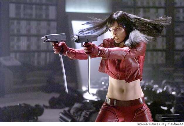 "In this photo provided by Sreen Gems, Milla Jovovich stars as Violet, a rogue warrior bent on protecting her new race in ""Ultraviolet."" (AP Photo/Screen Gems/Jay Maidment)"
