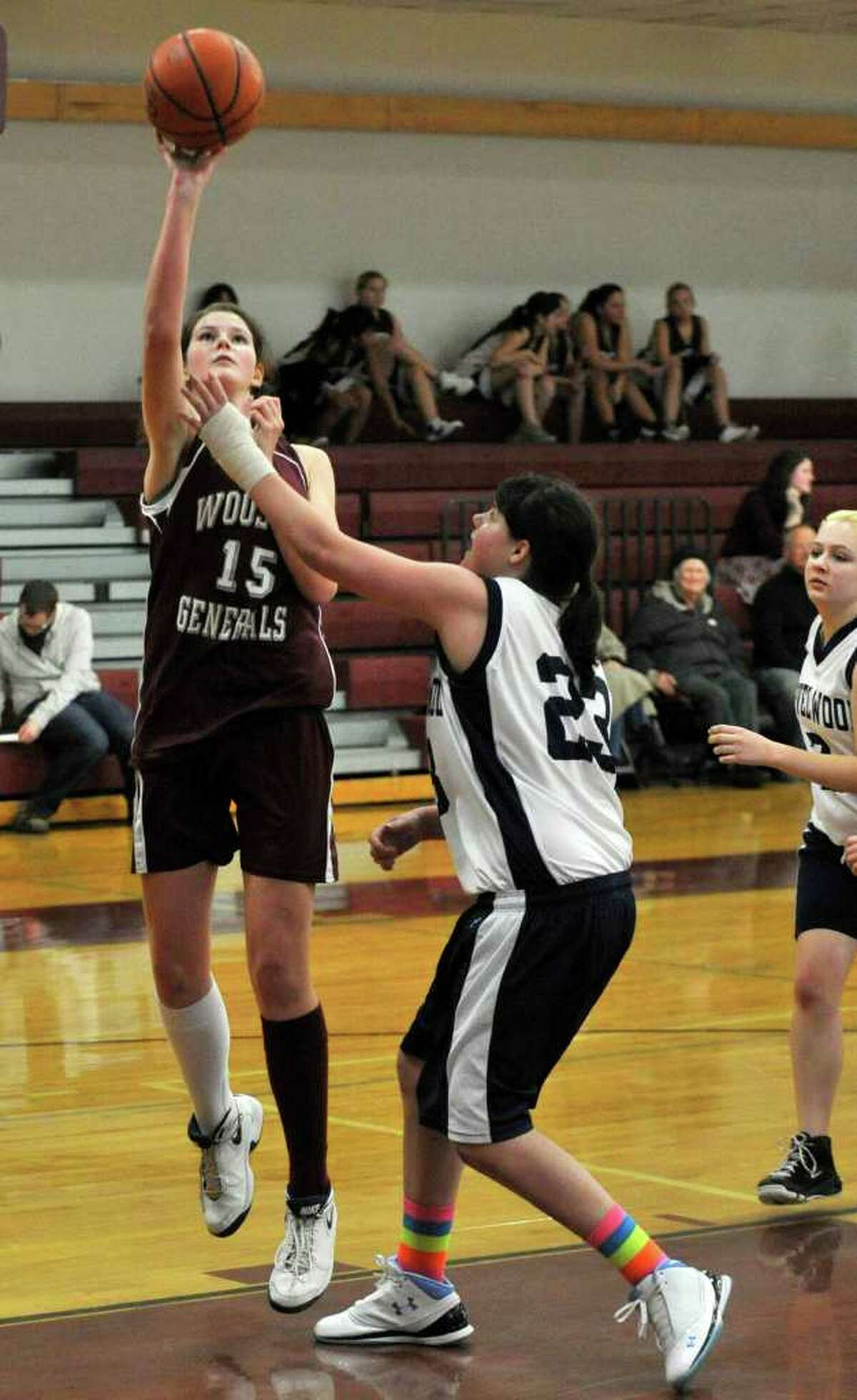 Wooster's Blair Hamilton shoots while under pressure from Marvelwood's Molleigh Sanes during their game at Wooster School in Danbury on Wednesday, Feb. 15, 2012. Wooster won 48-27 giving coach David MacNutt his 700th career victory.