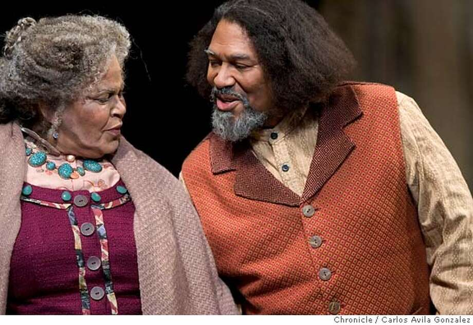 """GEM17_061_CAG.CR2  Michele Shay as Aunt Esther, left, and Steven Anthony Jones as Solly Two Kings, right, in ACT production of the late August Wilson's """"Gem of the Ocean,"""" a major event, first play in Wilson's 10-play cycle about the African American experience in the 20th century. Be sure to get shots of Michele Shay (Aunt Ester) with Owiso Odera (Citizen) or Steven Anthony Jones (Solly Two Kings). .  Photo by Carlos Avila Gonzalez / The San Francisco Chronicle  Photo taken on 2/9/06 in San Francisco, CA. MANDATORY CREDIT FOR PHOTOG AND SAN FRANCISCO CHRONICLE/ -MAGS OUT Photo: Carlos Avila Gonzalez"""