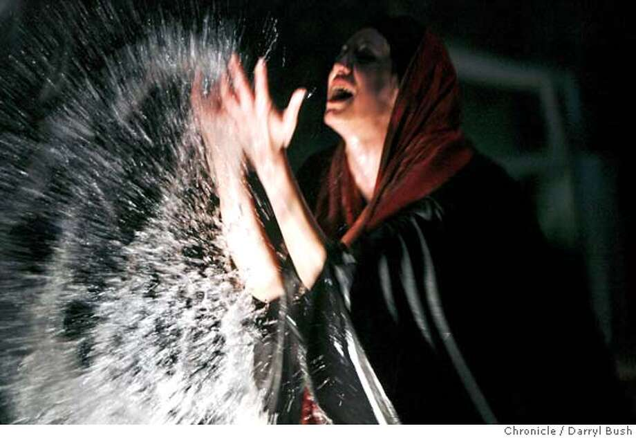 """desire27_0363_db.jpg  Mozhan Marn� throws water over herself as she performs in """"9 parts of desire,"""" at the Berkeley Rep's Thrust Stage.  Event on 1/19/06 in Berkeley.  Darryl Bush / The Chronicle MANDATORY CREDIT FOR PHOTOG AND SF CHRONICLE/ -MAGS OUT Photo: Darryl Bush"""