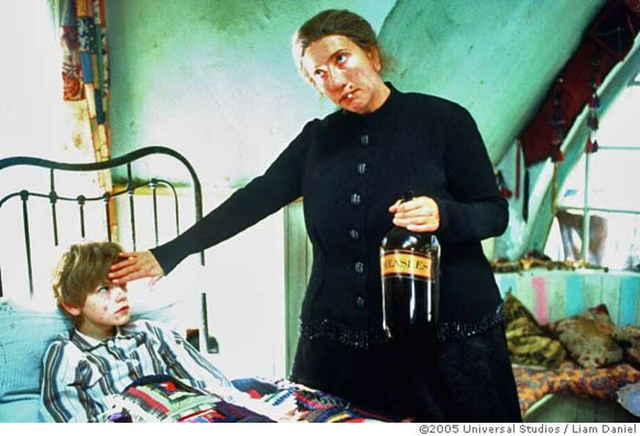 """EMMA THOMPSON as the magical Nanny McPhee tends to the """"ill"""" Simon (THOMAS SANGSTER) in the dark and witty fable Nanny McPhee. Nanny McPhee will be released in theaters on January 27, 2006.  Credit: Liam Daniel  �2005 Universal Studios. All Rights Reserved. Photo: Liam Daniel"""