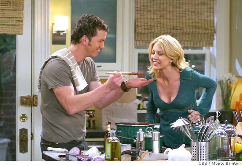 "caption: ""Girlfriend""-- COURTING ALEX, starring Jenna Elfman, is a new comedy series about Alex (Elfman), an attractive, single attorney, who has everything life has to offer...except a life. It premieres Monday, Jan. 23 (9:30-10:00 PM, ET/PT) on the CBS Television Network. Josh Randall stars as Scott, an impulsive renaissance man, who repeatedly attempts to woo the generally all-business, though secretly smitten, Alex after meeting her during a business negotiation involving his tavern. Photo: Monty Brinton/CBS�2005 CBS Broadcasting Inc. All Rights Reserved.copyright:  CBS / Monty Brinton  MANDATORY CREDIT; NO ARCHIVE; ; FOR NORTH AMERICAN USE ONLY Photo: MONTY BRINTON"