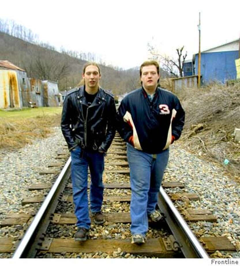"GOODMAN09 Shown: Cody Perkins (left) and Chris Johnson (right) walk the train tracks through their hometown in Eastern Kentucky in January of 2004. The boys are profiled over three years (1999-2002) from ages 15 to 18 in ""Country Boys,"" a film by David Sutherland airing January 9, 10, and 11, 2006 on PBS. Photo: FRONTLINE"