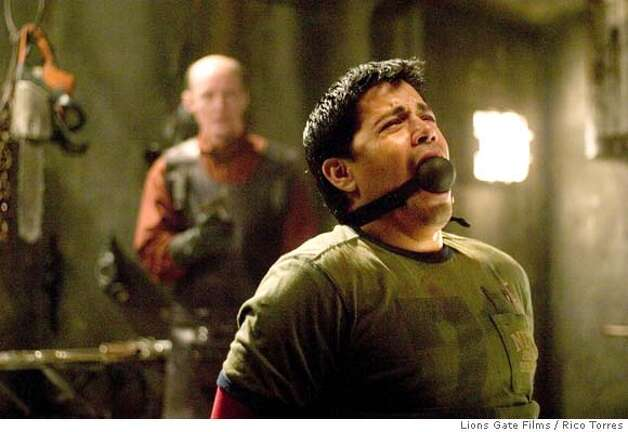 "Actor Jay Hernandez (R) appears in a scene from the new film ""Hostel"" in this undated publicity photograph. The film, directed by Eli Roth, features brutal scenes of torture and violence and is about three backpackers who head to a Slovakian city that promises to meet their hedonistic expectations, with no idea of the horror that awaits them. The film opens on Thursday in the U.S. NO ARCHIVES REUTERS/Rico Torres/Lions Gate Films/Handout  Lions Gate Films / Rico Torres  0 Photo: HO"