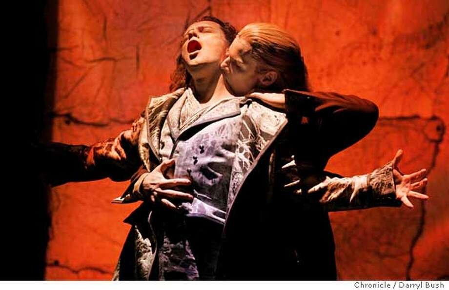 "Lestat, sung by Hugh Panaro, prepares to sink his teeth into Louis (Jim Stanek) in ""Lestat,"" at the Curran Theatre. The musical is scheduled to run on Broadway in the spring. Chronicle photo by Darryl Bush"