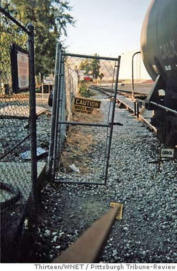 EXPOS�: AMERICA'S INVESTIGATIVE REPORTS Think Like a Terrorist (Part 1) Open gates, torn fences and unguarded rail lines allow unfettered access to a facility along a Union Pacific spur in a San Francisco suburb. Credit: Pittsburgh Tribune-Review  Producer: Thirteen/WNET New York  Contact: Lisa Batchelder, Thirteen/WNET, 212/560-2074 Photo: Pittsburgh Tribune-Review